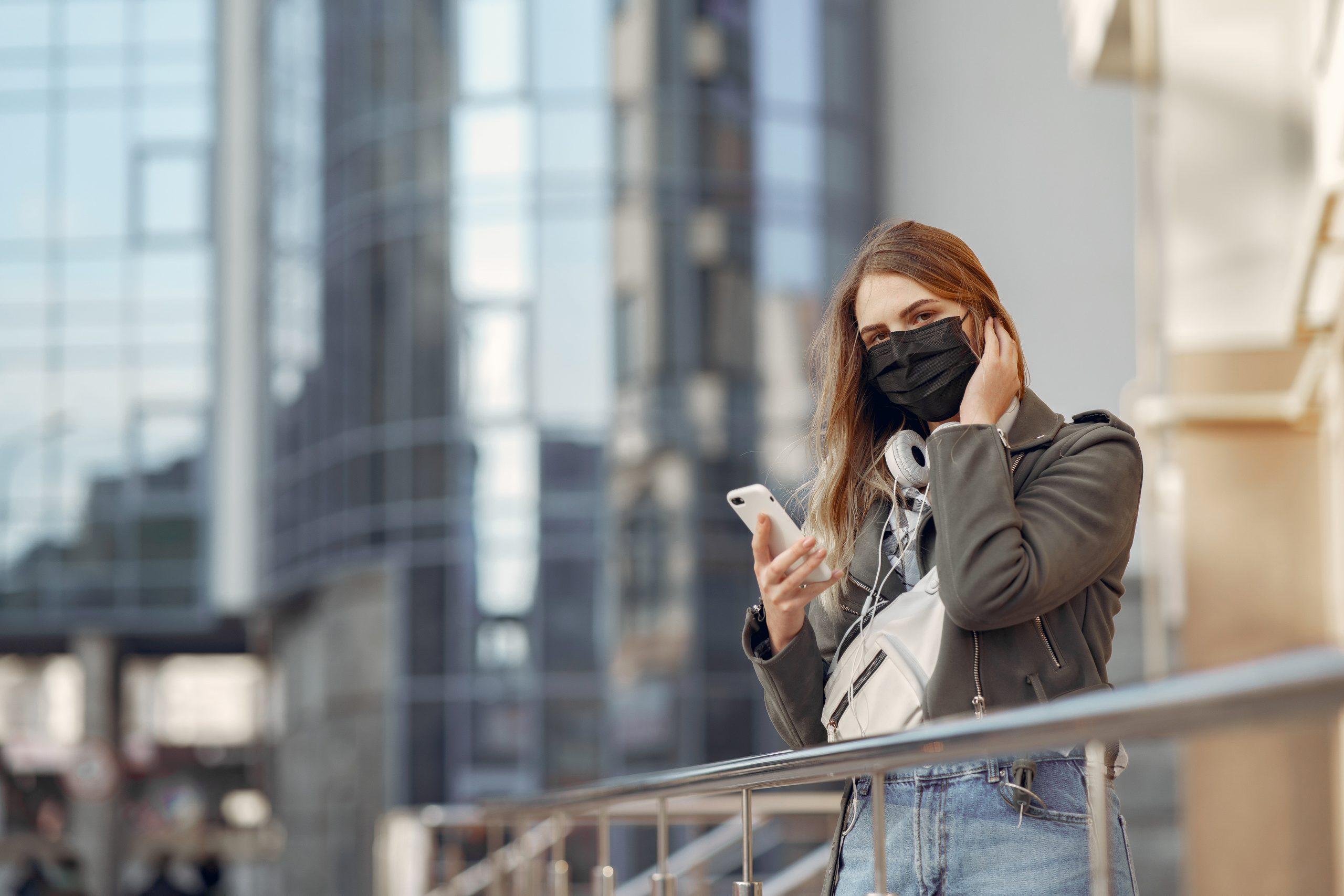 girl wearing mask phone headphones